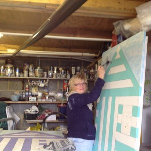 Lynda painting one of the three beach huts, for our new 'Garden Residents,' to live in. Namely, Billy, Bertha and Betty!