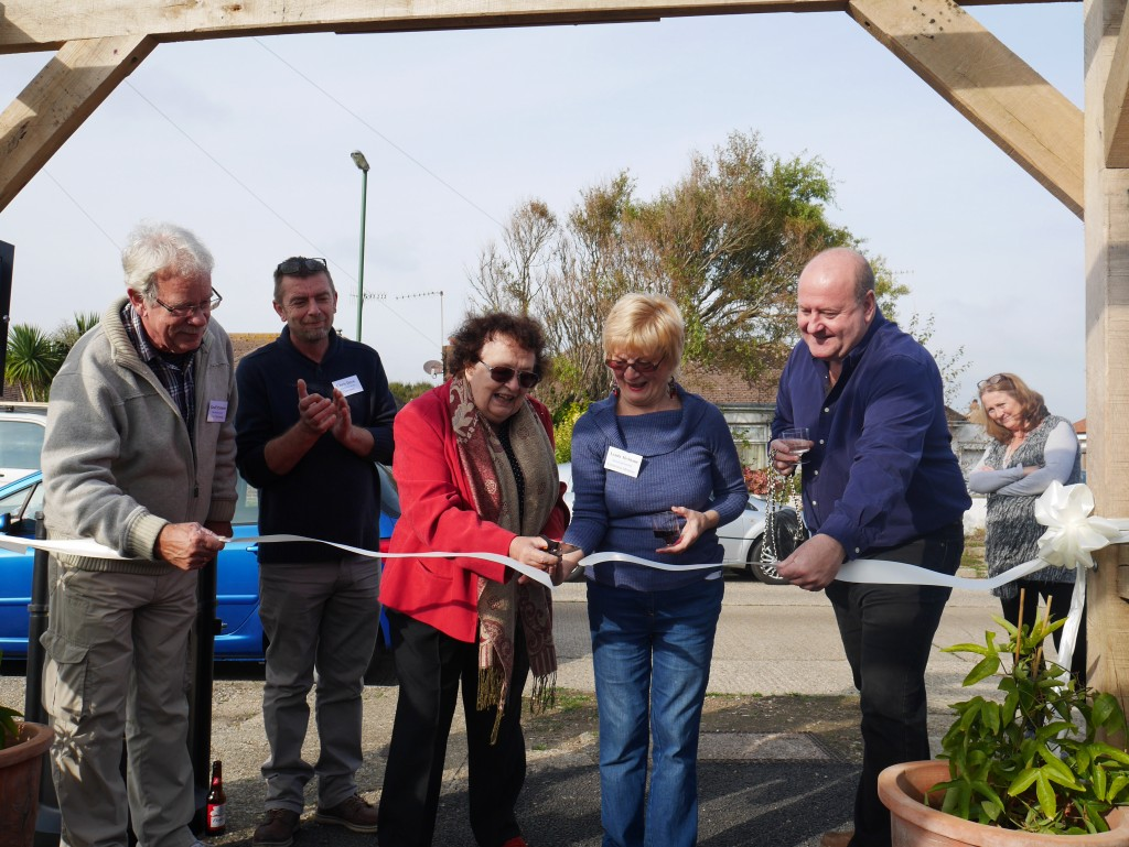 Councillor Janet Mockridge WSCC cutting the ribbon with West Beach Committee member Lynda McShane. Looking on Councillors Mick Clark WSCC and Geoff Patmore ADC, not forgetting our Chairman Chris Drew.